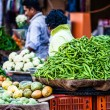 Various different vegetables and mango in wooden baskets at the market, Kumly, Kerala, India — Stock Photo #34548907