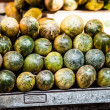 Various different vegetables and mango in wooden baskets at the market, Kumly, Kerala, India — Stock Photo #34549187