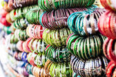 Rows of colorful wooden hand-painted bracelets — Stock Photo