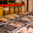 Jars of herbs and powders in a indian spice shop. — Stock Photo #34605125