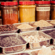 Jars of herbs and powders in a indian spice shop. — Stock Photo #34605227
