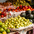 Asian farmer's market selling fresh fruits — Stock Photo