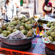 Fresh organic white bulb Custard Apple for sale at a market for farm products, India — Stock Photo