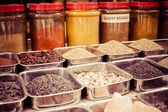 Jars of herbs and powders in a indian spice shop. — Stock Photo