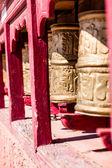 Buddhist prayer wheels in Tibetan monastery with written mantra. India, Himalaya, Ladakh — Stock Photo