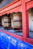 Buddhist prayer wheels in Tibetan monastery with written mantra. India, Himalaya, Ladakh — Foto de Stock