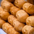 Traditional polish smoked cheese oscypek on outdoor market in Zakopane — Stock Photo #35662717