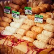 Traditional polish smoked cheese oscypek on outdoor market in Zakopane — Foto de stock #35662775