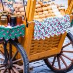 Traditional polish smoked cheese oscypek on outdoor market in Zakopane — Stock Photo #35663211