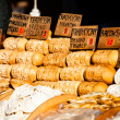Traditional polish smoked cheese oscypek on outdoor market in Zakopane — Foto Stock