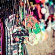 Bags hanging at outdoor market — Stock Photo