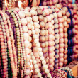 Foto Stock: Wooden colored beads on display on market inZakopane, Poland