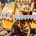 Traditional polish smoked cheese oscypek on outdoor market in Zakopane — Stock Photo #35668807