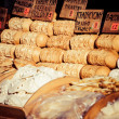 Traditional polish smoked cheese oscypek on outdoor market in Zakopane — Foto Stock #35668943