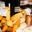 Traditional polish smoked cheese oscypek on outdoor market in Zakopane — ストック写真 #35669069