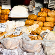 Traditional polish smoked cheese oscypek on outdoor market in Zakopane  — Stock Photo