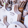 Carved cups, spoons, forks and other utensils of wood — Stock Photo #35669737