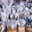 Carved cups, spoons, forks and other utensils of wood — Stock Photo #35669841