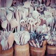 Foto Stock: Carved cups, spoons, forks and other utensils of wood