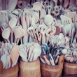 Stock fotografie: Carved cups, spoons, forks and other utensils of wood