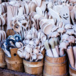 图库照片: Carved cups, spoons, forks and other utensils of wood