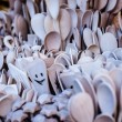 Carved cups, spoons, forks and other utensils of wood — Stock Photo #35669949