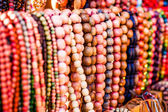 Wooden colored beads on display on the market inZakopane, Poland — Stock fotografie