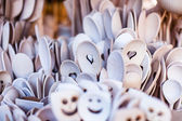 Carved cups, spoons, forks and other utensils of wood — Stock Photo