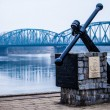 图库照片: Poland - Torun famous truss bridge over Vistulriver. Transportation infrastructure.