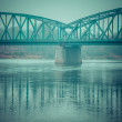 Стоковое фото: Poland - Torun famous truss bridge over Vistulriver. Transportation infrastructure.