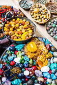 Colorful gemstones on sale at a flea market in Jerusalem, Israel. Multicolored background. — Stock Photo
