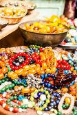 Colorful gemstones on sale at a flea market in Jerusalem, Israel. Multicolored background. — Stock Photo