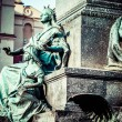 Krakow - fragments of the monument of Adam Mickiewicz. — Stock Photo #37699993