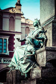 Krakow - fragments of the monument of Adam Mickiewicz. — Stock Photo