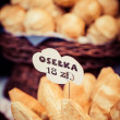 Stock Photo: Traditional polish smoked cheese oscypek on outdoor market in Krakow, Poland.