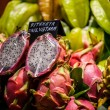 Stock Photo: Lot of dragon fruits in tropical market