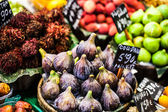 Colourful fruit and figs at market stall in Boqueria market in Barcelona. — Stock Photo