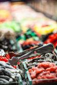 Market stall full of candys in La Boqueria Market. Barcelona. Catalonia. — Stock Photo