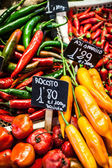 Red and green peppers hung to dry in the La Boqueria market Barcelona — Stock Photo