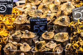 Mushrooms at a stand in the Boqueria Market, in Barcelona, Spain. — Stock Photo