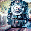 Old steam locomotive against blue cloudy sky, vintage train — Stock Photo