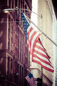 American flags outside a building — Stock Photo