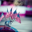 Traditional USA parade old car with flags — Stock Photo #44985871