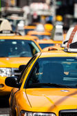 Yellow cab speeds through Times Square in New York, NY, USA.  — Stock Photo