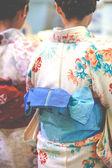 Japanese women wear a traditional dress called Kimono for Sakura viewing at Kiyomizu temple in Kyoto — Stock Photo