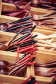 Wooden spoon small teaspoons new unused made of brown hard wood for sale on a street market in Thailand — Stock Photo