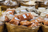 Greek spices with price tags closeup on market table  — Stock Photo