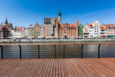 City of Gdansk (Danzig), Poland. Panoramic view of Old Town houses with reflections on Motlawa river waters — Stock Photo