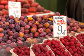 Red raspberries in boxes at local farm market in Poland. — Stock Photo