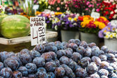 Plums on the market stand in Poland. — Stock Photo